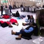 People from VS 004 sleeping at JFK T4 on December 26 (via http://Jason-Cochran.com)
